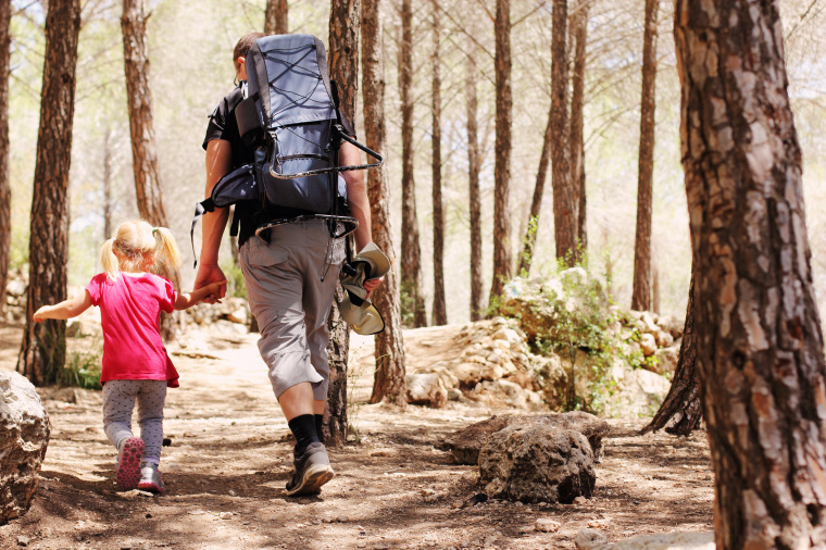 Father hiking with daughter